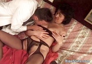 older slut in sexy black stockings