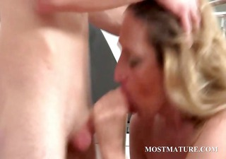 golden-haired mom takes jock in throat and pussy